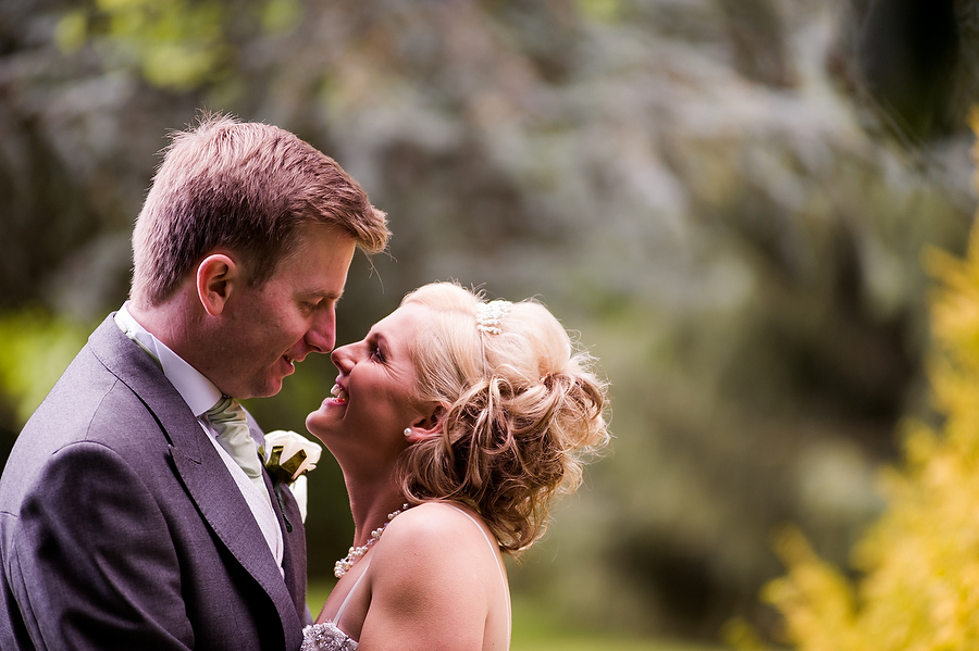 Close intimate portrait of Bride and Groom at Rodbaston Hall in Stafford by Award Winning Wedding Photographer Barry James