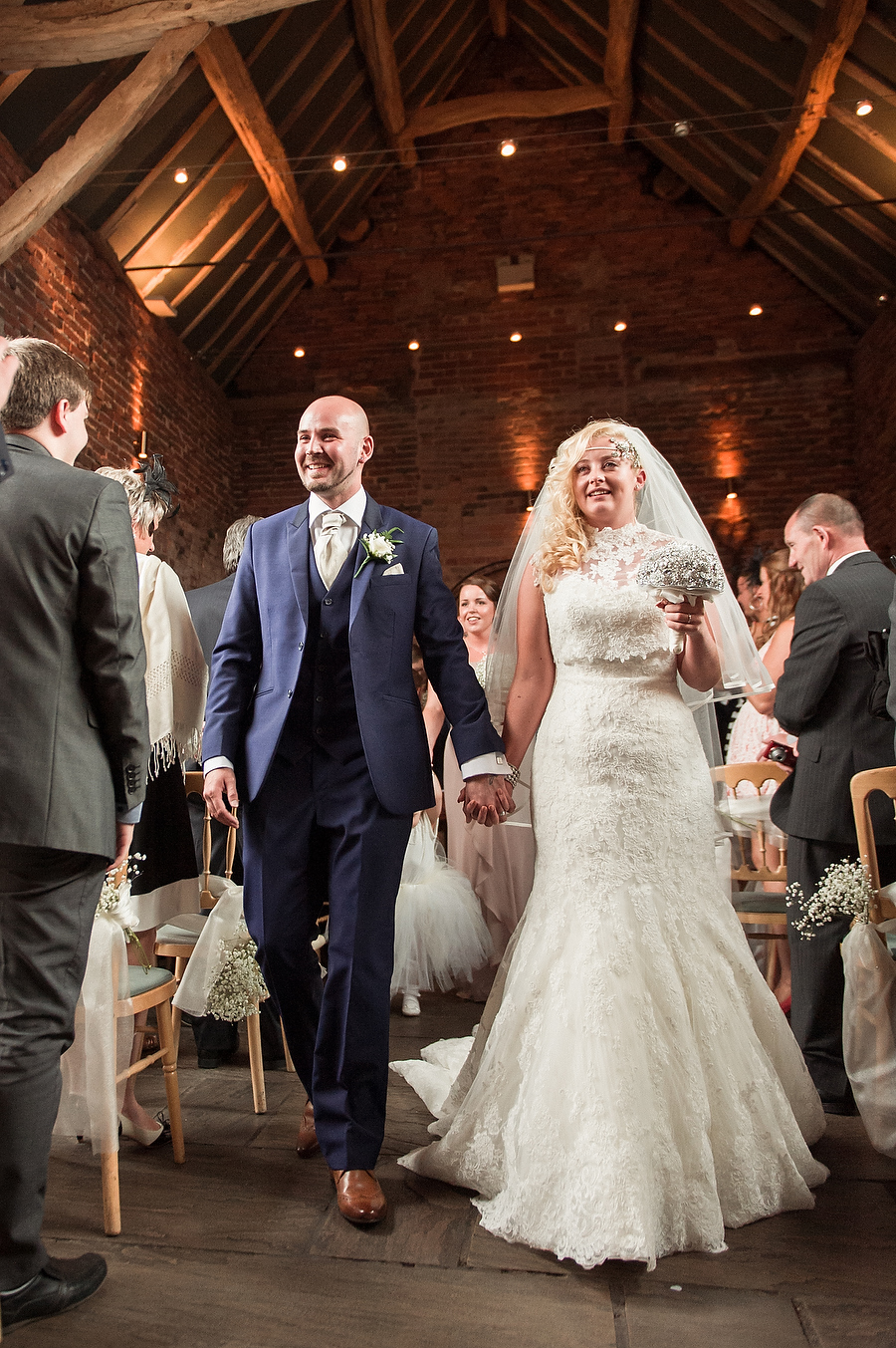Happy exit of Bride and Groom from Oat Barn ceremony at Packington Moor in Lichfield by Lichfield Reportage Wedding Photographer Barry James