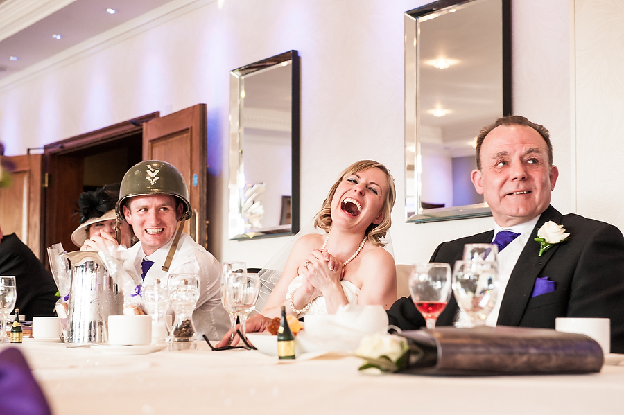 Capturing fabulous photo of brides reaction to speeches at The Moat House in Acton Trussell by Recommended Wedding Photographer Barry James