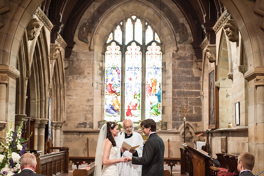 Beautiful traditional photograph in a contemporary style during ceremony at St Johns Church in Armitage by Contemporary Wedding Photographer Barry James