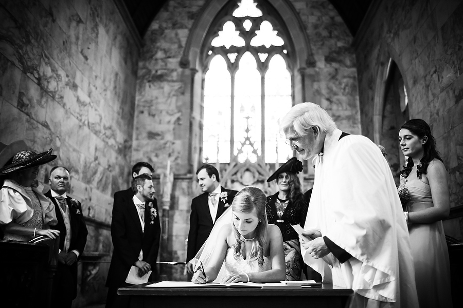 Creative photograph during the signing of the register at Dunstall in Wolverhampton by Dunstall Wedding Photographer Barry James