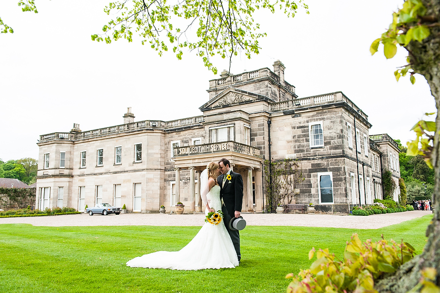 Contemporary and creative portraiture with the grand hall in the background at Dunstall in Wolverhampton by Wolverhampton Wedding Photographer Barry James