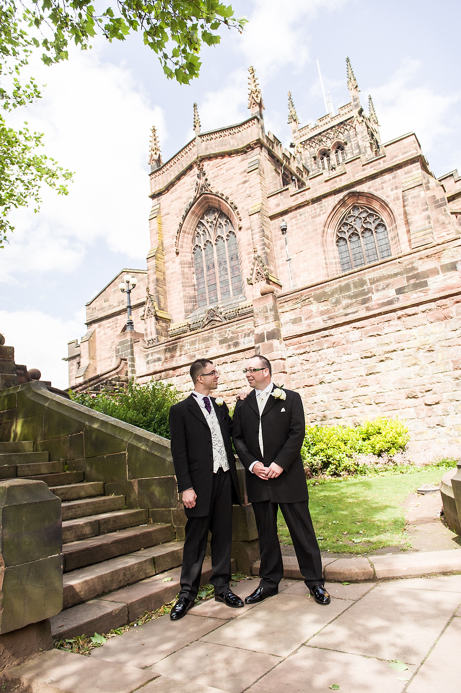 Contemporary relaxed portrait of groom at Collegiate Church in Wolverhampton by Contemporary Wedding Photographer Barry James