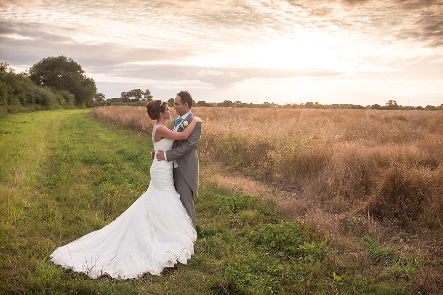 Golden hour portraits with a beautiful couple in the fields at Alrewas Hayes in Burton by Burton Wedding Photographer Barry James