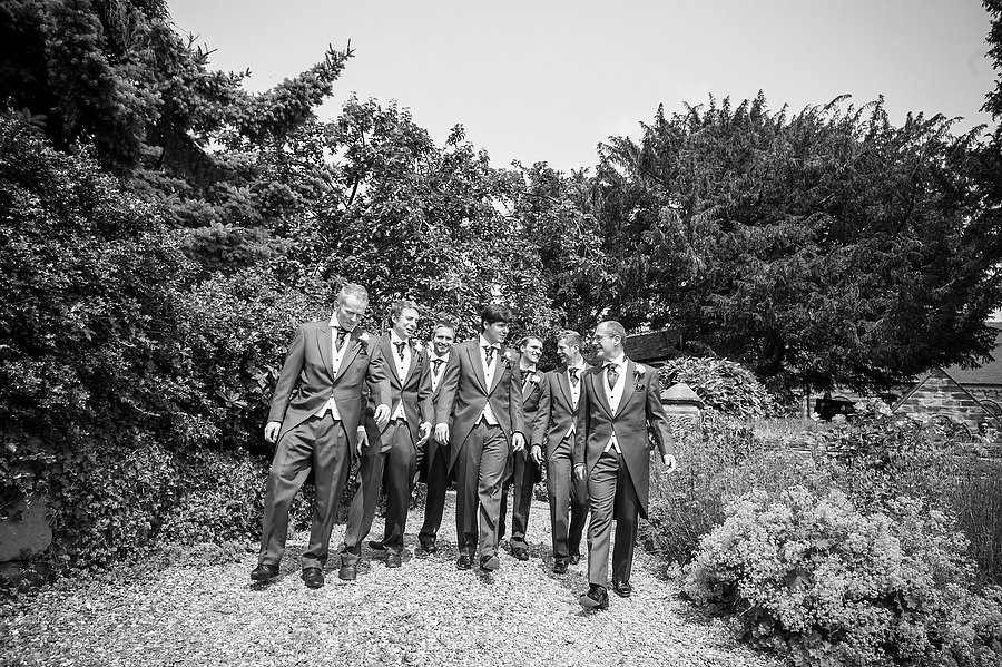 Creative candid portrait of Groom and Groomsmen arriving at St Johns Church in Armitage by Stafford Wedding Photographer Barry James