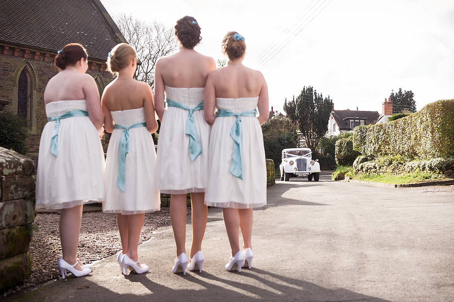 Storytelling moment and the Bridesmaids await the arrival of the Bride at Walton on the Hill in Stafford by Stafford Contemporary Wedding Photographer Barry James