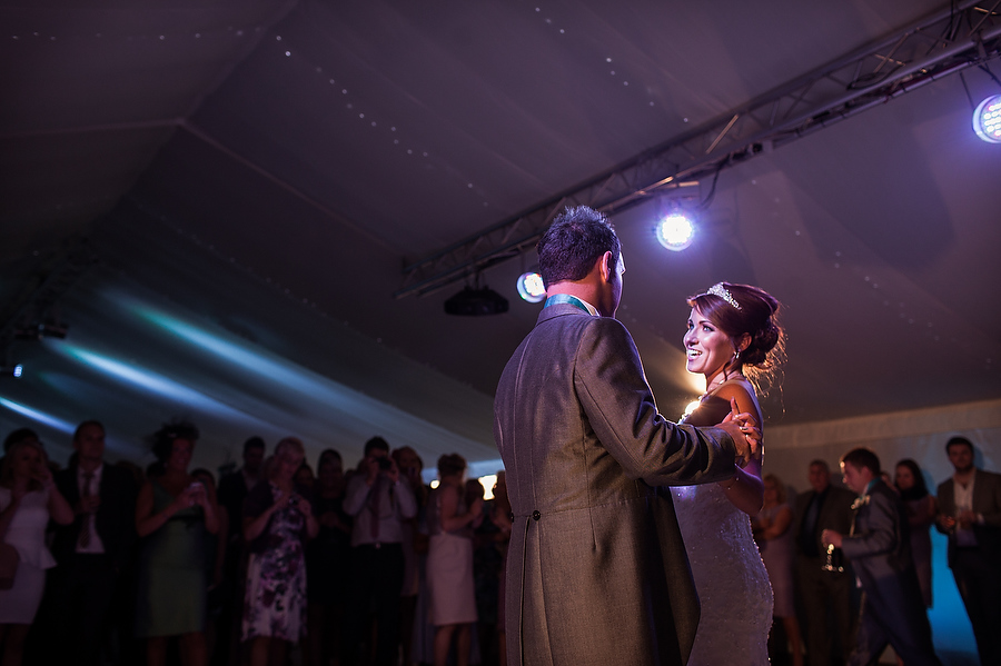 Beautiful reportage photography of first dance in the marquee at Alrewas Hayes in Burton by Burton Wedding Photographer Barry James