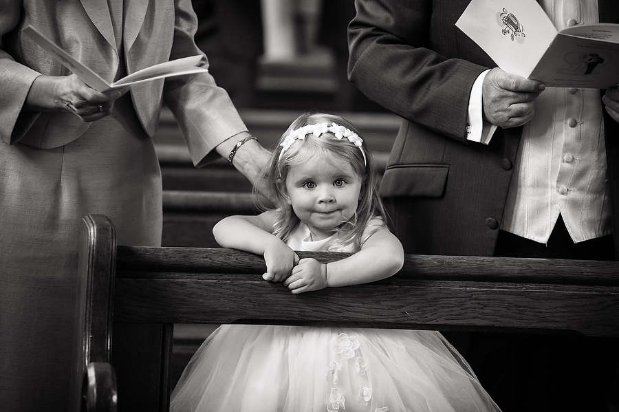 Candid photographs that capture the character of children during ceremony at Calderfields Golf and Country Club in Walsall by Venue Recommended Wedding Photographer Barry James