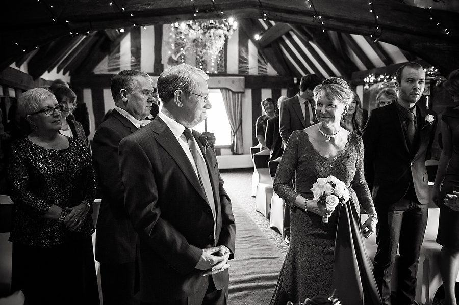 Reportage photos capture the story of the wedding day, here showing the deep feeling between the Bride and Groom during wedding ceremony at Moat House in Acton Trussell by Stafford Contemporary Wedding Photographer Barry James