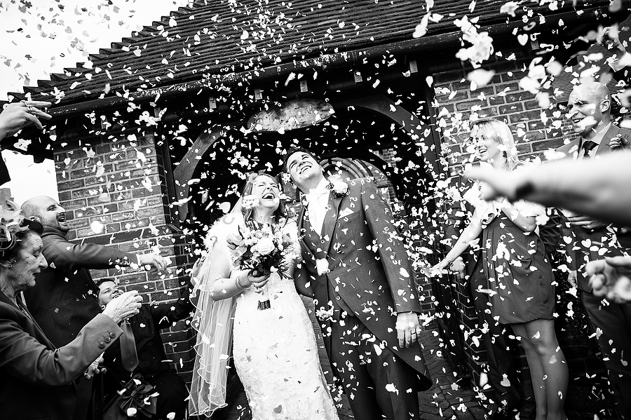 Capturing a timeless moment during the confetti at All Saints Church in Streetly by Aldridge Wedding Photographer Barry James
