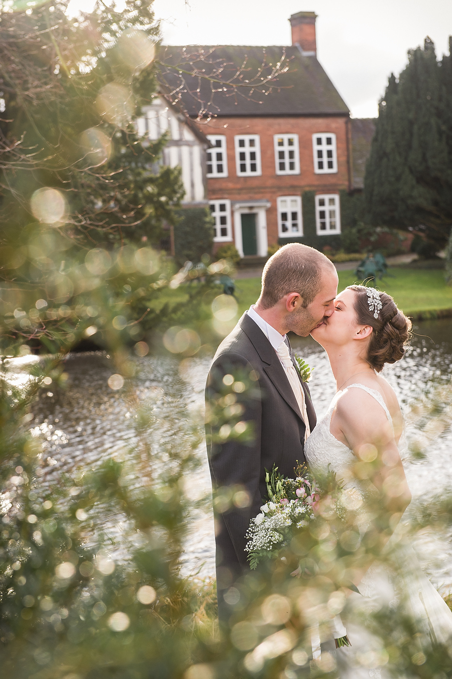 Creative Spring portraits of Bride and Groom at The Moat House in Stafford by Stafford Contemporary Wedding Photographer Barry James