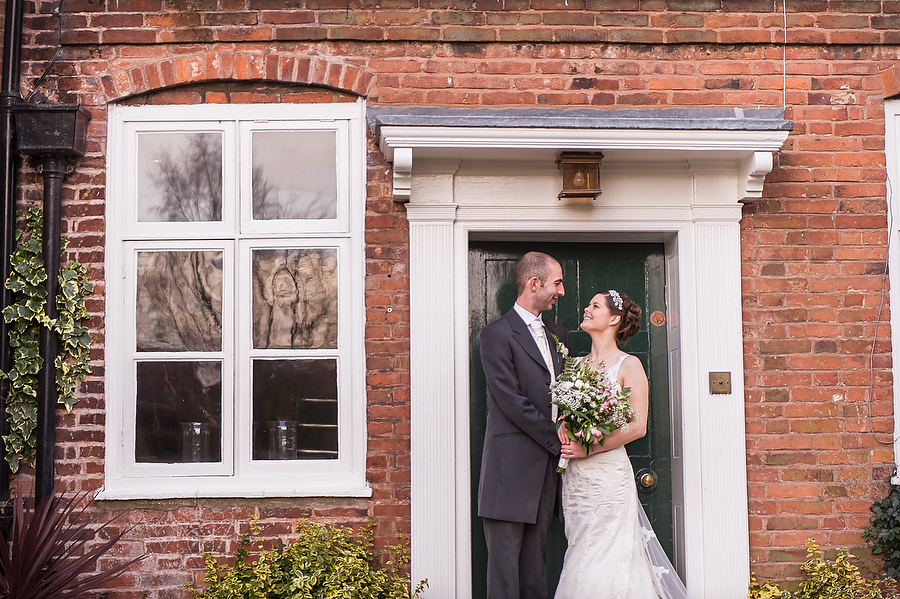 Stunningly simple portrait of the Bride and Groom on the door at The Moat House in Stafford by Stafford Contemporary Wedding Photographer Barry James