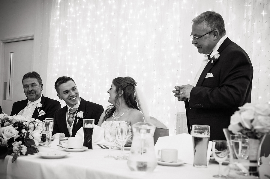 Candid photographs of the speeches convey the story of the day at Hawkesyard Estate in Ruegley by Recommended Wedding Photographer Barry James