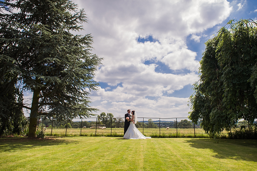 Elegant contemporary portraits in the grounds of Mythe Barn in Atherstone by Warwickshire Wedding Photographer Barry James