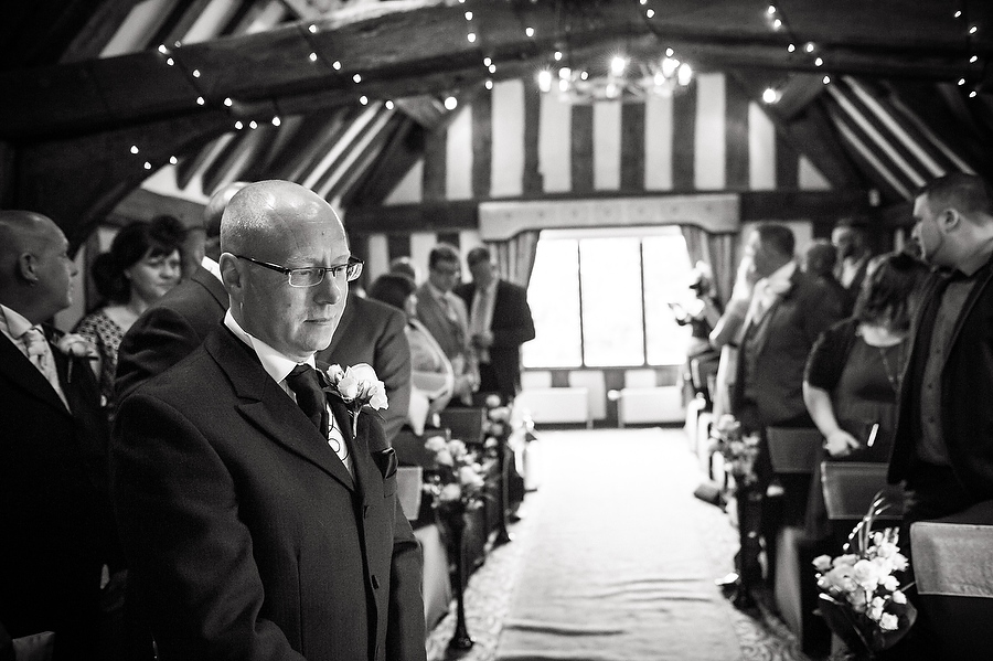 Groom patiently waits for his bride of The Moat House in Penkridge by Cannock Candid Wedding Photographer Barry James