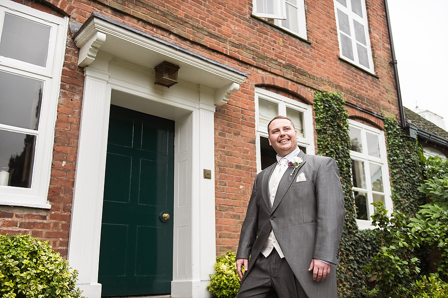Groom has his moment of stardom in this elegant portrait at The Moat House in Acton Trussell by Recommended Wedding Photographer Barry James