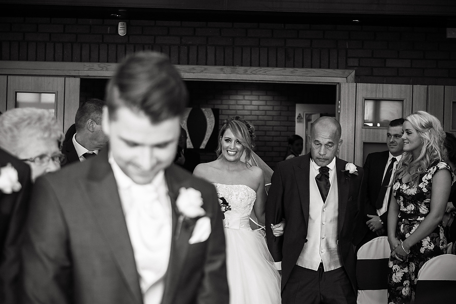 Candid photograph captures the energy and emotion during the wedding ceremony at Calderfields Country Club in Walsall by Recommended Wedding Photographer Barry James