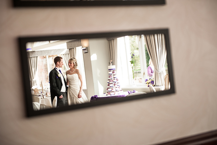 Utilising mirrors for creative portrait of Bride and Groom in Acton Suite at The Moat House in Acton Trussell by Recommended Wedding Photographer Barry James