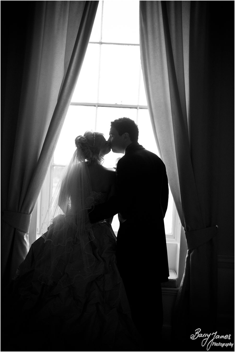 Unobtrusive reportage wedding photos of Christmas wedding at Somerford Hall in Brewood by Award Winning Wedding Photographer Barry James
