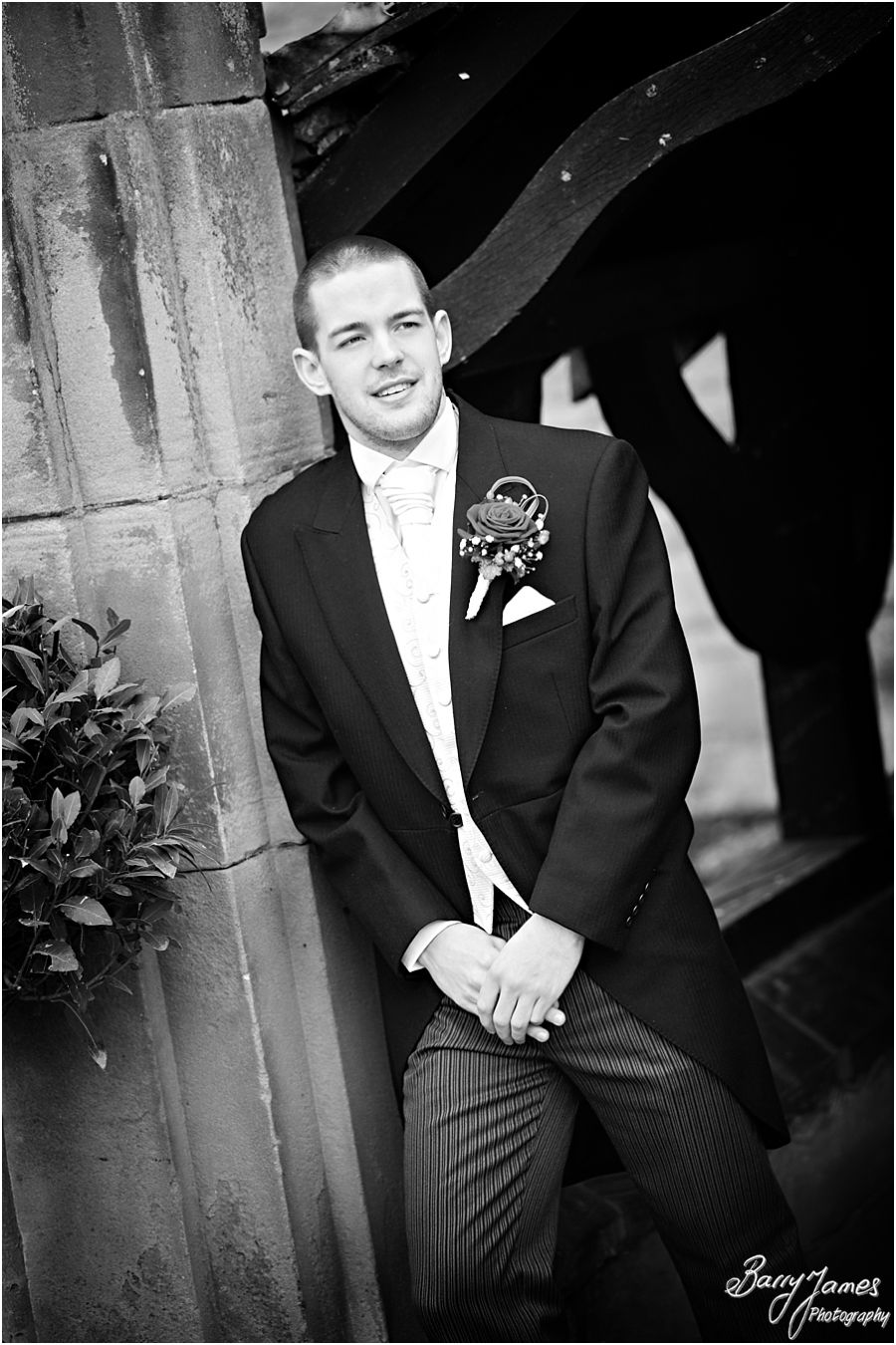 Creative natural photos of groom at New Hall in Walmley by Sutton Coldfield Wedding Photographer Barry James