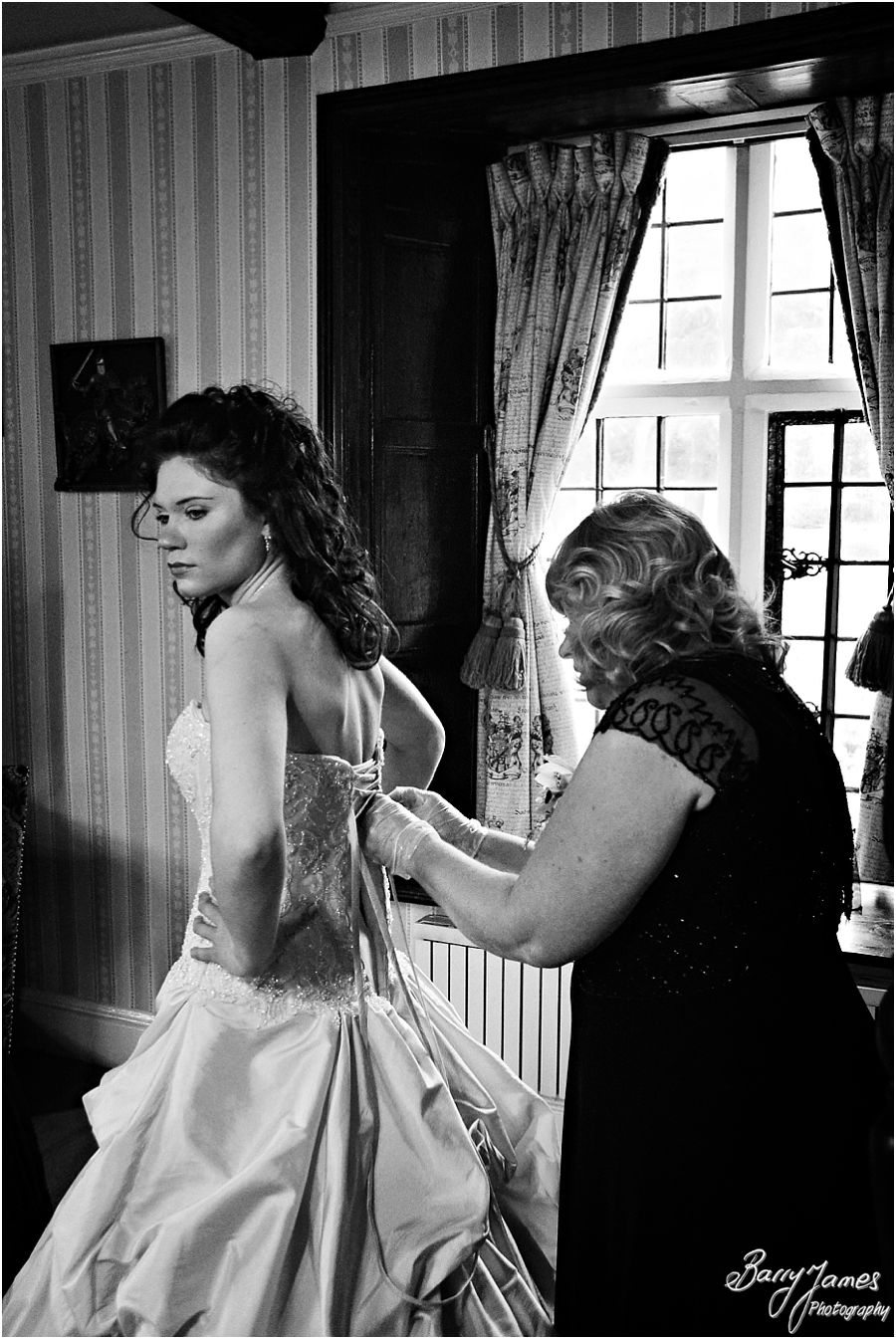 Creative candid photos of morning preparations at New Hall in Walmley by Award Winning Wedding Photographer Barry James
