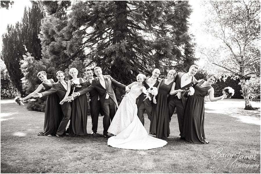Relaxed family photographs during drinks reception at Rodbaston Hall in Penkridge by Cannock Wedding Photographer Barry James