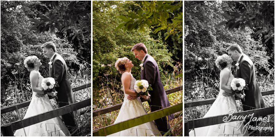 Fun creative portraits of Bride and Groom around gardens at Rodbaston Hall in Penkridge by Cannock Wedding Photographer Barry James