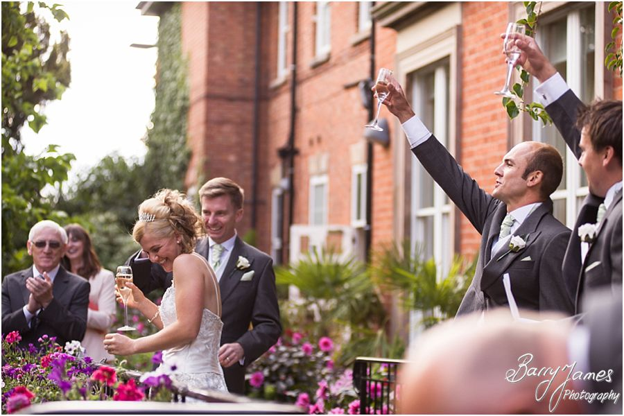 Telling the wedding story with fabulous candid photographs of guests during wedding reception at Rodbaston Hall in Penkridge by Cannock Wedding Photographer Barry James