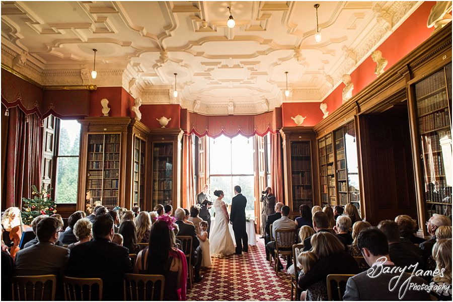 Contemporary and creative wedding photographs of wedding ceremony in Library at Sandon Hall in Stafford by Stafford Contemporary Candid Wedding Photographer Barry James