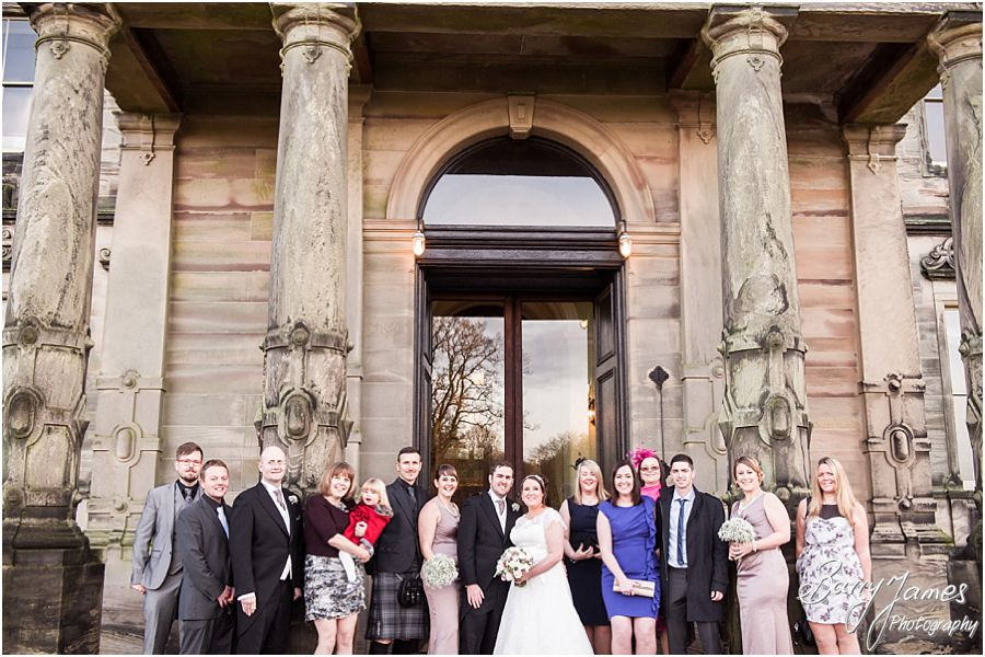 Creative beautiful wedding portraits of the Bridal Party and family on the front facade at Sandon Hall in Stafford by Stafford Contemporary Wedding Photographer Barry James