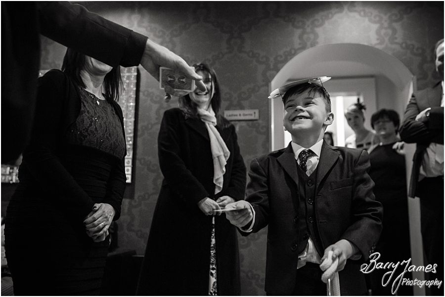 Chris Peskett Magician entertaining the wedding guests at Alrewas Hayes in Burton upon Trent by Contemporary and Candid Wedding Photographer Barry James