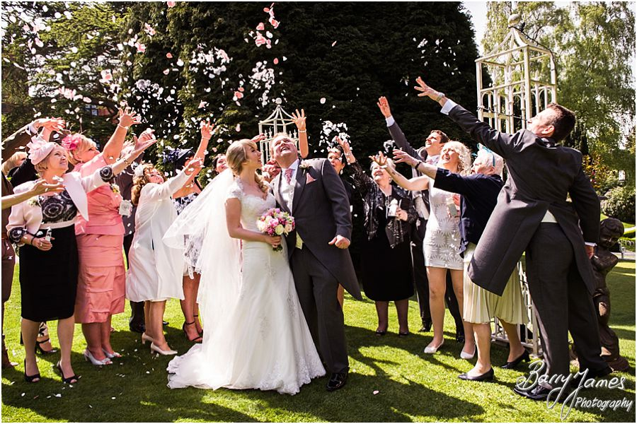 Confetti fun at Hawkesyard Hall in Rugeley by Rugeley Professional Wedding Photographer Barry James
