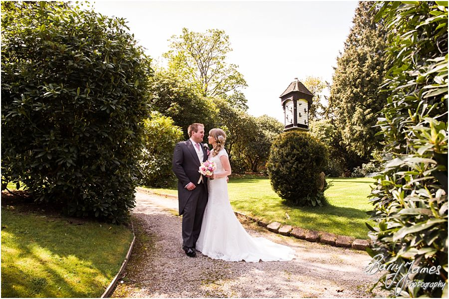Relaxed portraits of the Bride and Groom in the beautiful grounds at Hawkesyard Hall in Rugeley by Rugeley Professional Wedding Photographer Barry James