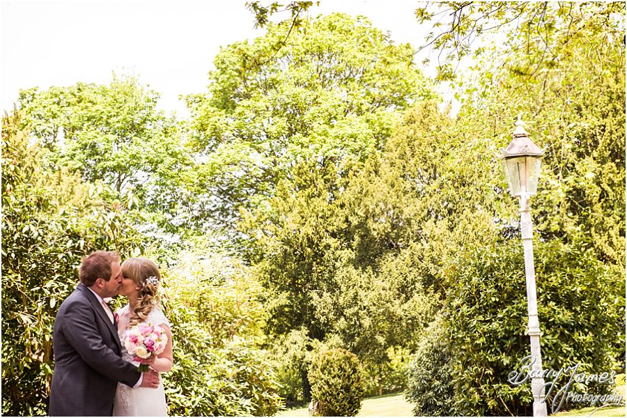 Relaxed fun portraits of the bride and groom in the gardens at Hawkesyard Hall in Rugeley by Rugeley Professional Wedding Photographer Barry James