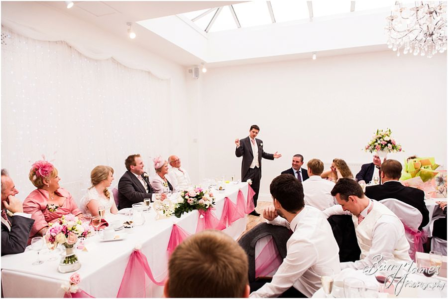 Candid photos of the speeches and fabulous entertaining reactions at Hawkesyard Hall in Rugeley by Venue Recommended Wedding Photographer Barry James