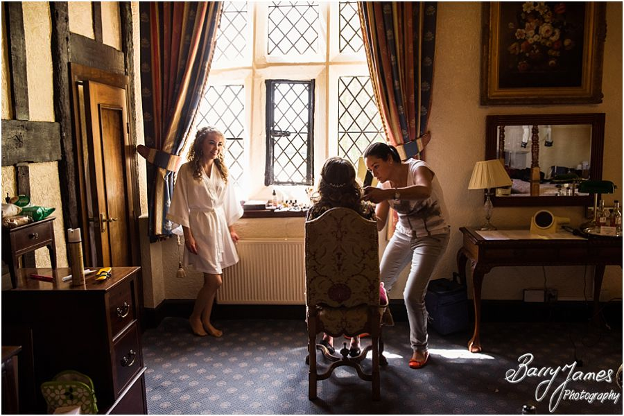 Relaxed morning photographs of bridal preparations at Albright Hussey Manor in Shrewsbury by Candid Wedding Photographer Barry James