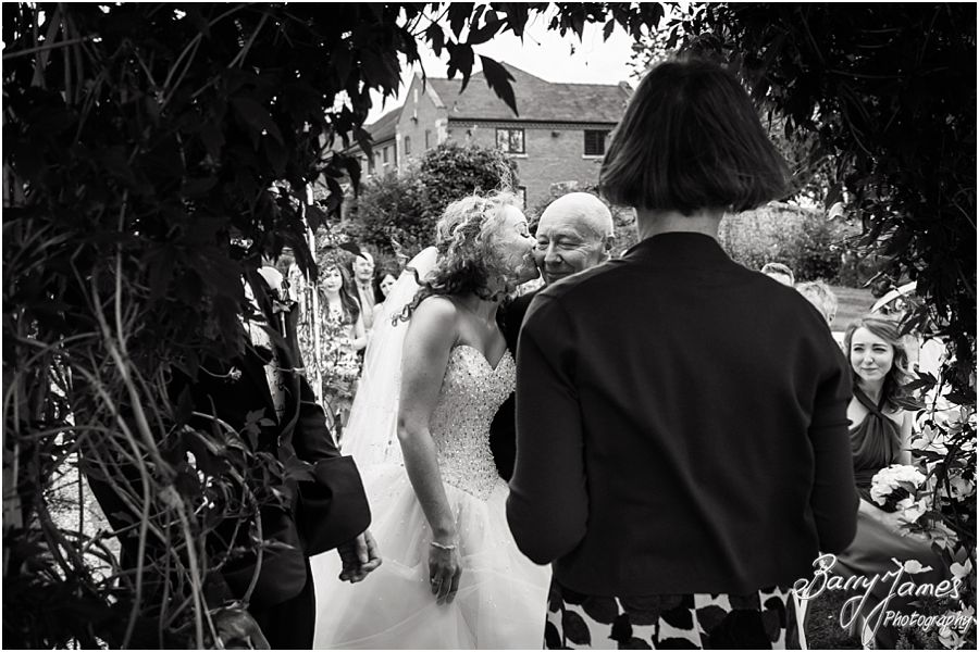 Storytelling photography of the beautiful outdoor ceremony at Albright Hussey Manor in Shrewsbury by Contemporary Wedding Photographer Barry James