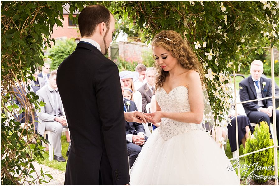 Candid photographs of the intimate outdoor ceremony at Albright Hussey Manor in Shrewsbury by Contemporary Wedding Photographer Barry James