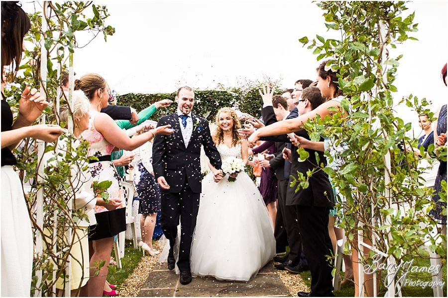 Confetti exit from wedding ceremony at Albright Hussey Manor in Shrewsbury by Contemporary Wedding Photographer Barry James