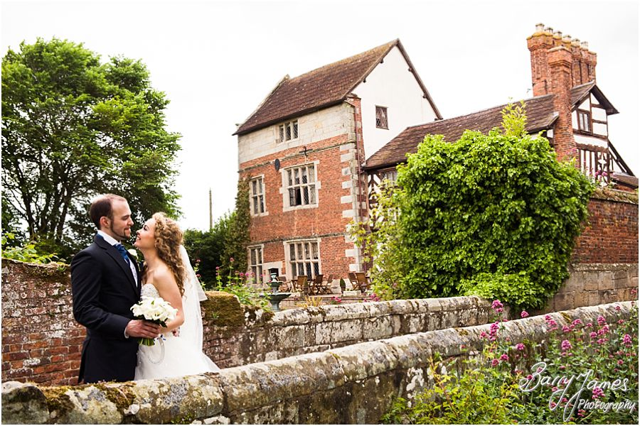 Creative bride and groom portraits around the wonderful gardens at Albright Hussey Manor in Shrewsbury by Contemporary Wedding Photographer Barry James