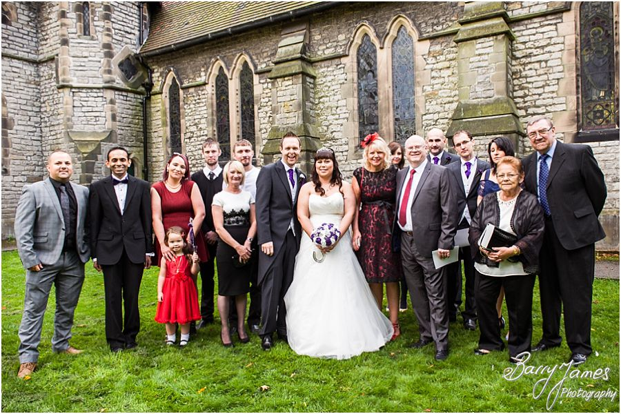 Relaxed family photographs in the church grounds at Rushall Parish Church in Walsall by Walsall Wedding Photographer Barry James