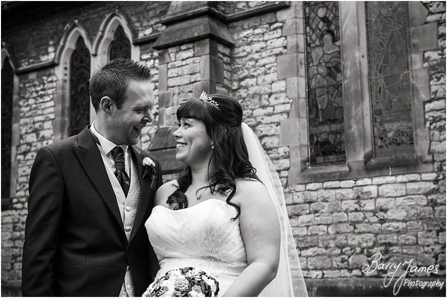 Fun and relaxed photographs of the bride and groom at Rushall Parish Church in Walsall by Walsall Wedding Photographer Barry James