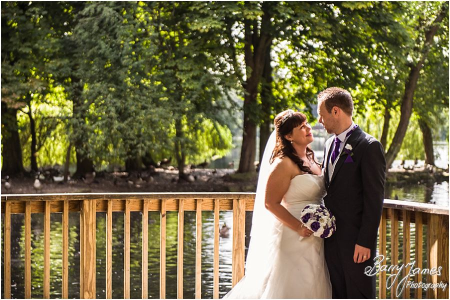 Stylish and creative portraits of the Bride and Groom on the lake at Walsall Arboretum in Walsall by Walsall Wedding Photographer Barry James