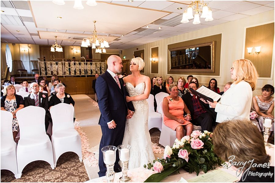Unobtrusive photos of the wedding ceremony at The Fairlawns in Walsall by Fairlawns Wedding Photographer Barry James