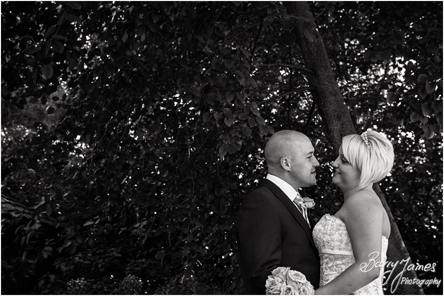 Beautiful intimate photos of the bride and groom around the gardens at The Fairlawns in Walsall by Fairlawns Wedding Photographer Barry James