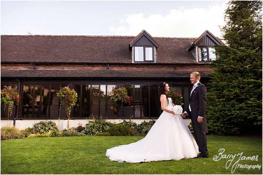 Relaxed contemporary portraits of the Bride and Groom in the lovely gardens at Oak Farm in Cannock by Cannock Wedding Photographer Barry James