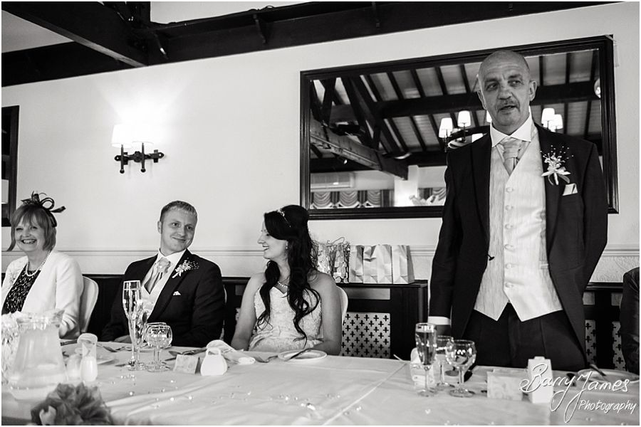 Creative candid photographs capturing the reaction to the Father of the Bride speech at Oak Farm in Cannock by Cannock Wedding Photographer Barry James