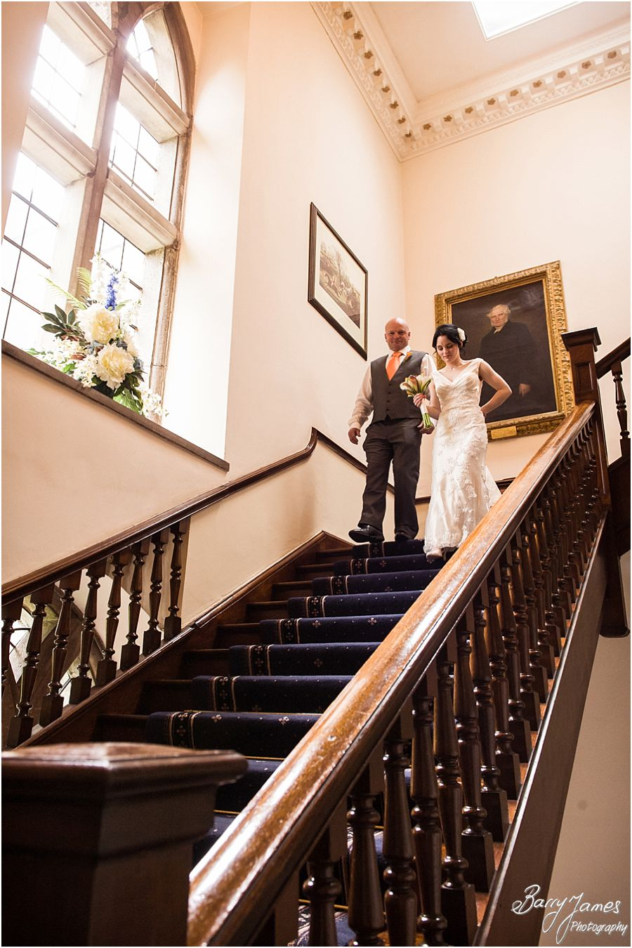 Capturing the bride walking down the stairs on the arm of her father at Clearwell Castle in Gloucestershire by Gloucester Wedding Photographer Barry James