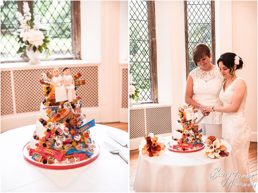 Fun wedding cake at Clearwell Castle in Gloucestershire by Gloucester Wedding Photographer Barry James
