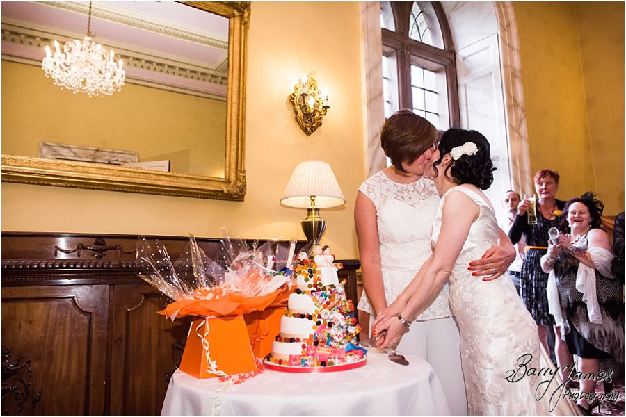 Cake cutting fun at Clearwell Castle in Gloucestershire by Gloucester Wedding Photographer Barry James